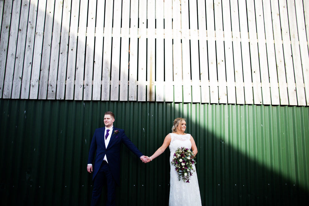 Bride and groom at a Sandhole Oak barn wedding