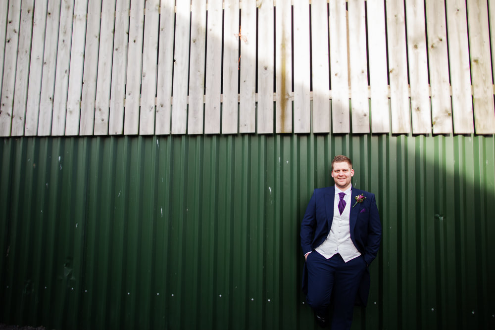 Groom portrait at a Sandhole Oak barn wedding