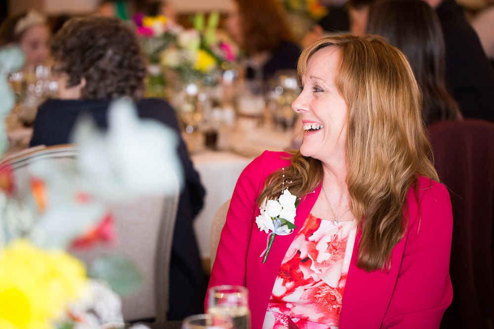 Guest smiling at a Sandhole Oak barn wedding