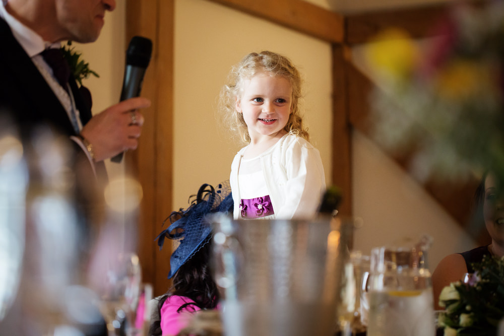 Flower girl at a Sandhole Oak barn wedding