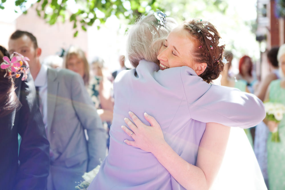 Bride hugging at a Haslington Hall wedding