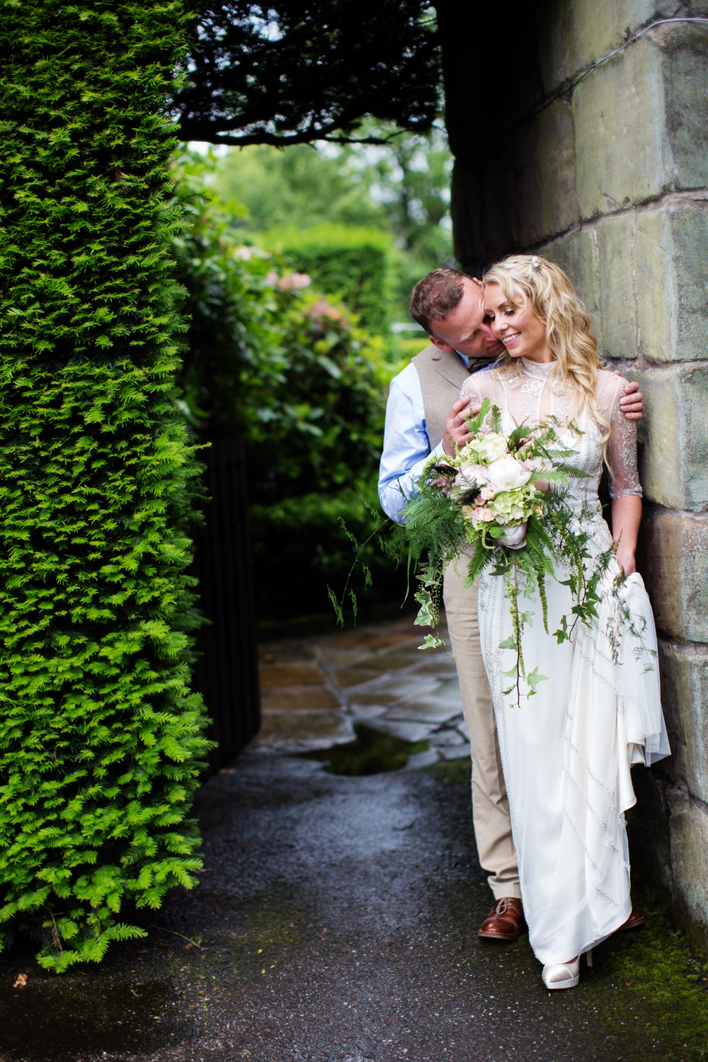 Bride and groom kiss at a Gawsworth hall wedding in Macclesfield