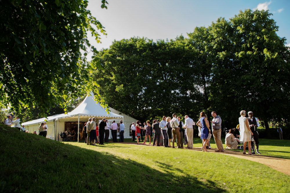 Wedding guests and marquee at Gawsworth hall in Macclesfield